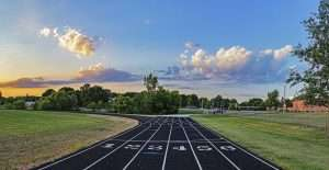 Track lanes 1-6 at sunset surrounded by green grass